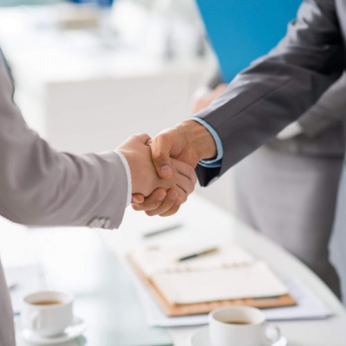 Hands of business people shaking hands after successful meeting